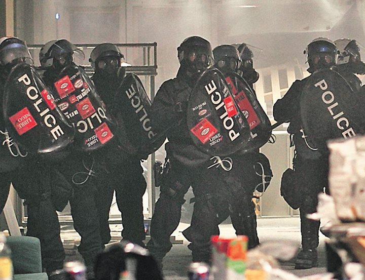Riot police after entering the Da Sève Building Occupation at UQAM earlier tonite.