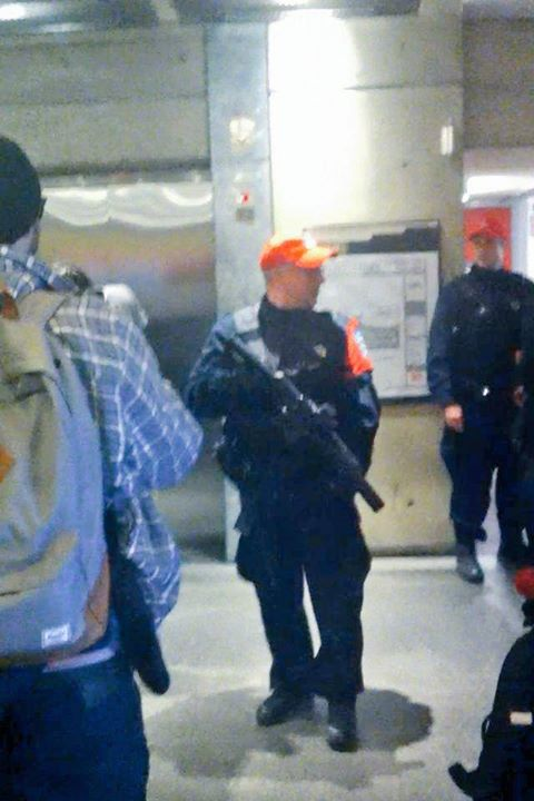 Montreal police officer with exposed weapon inside a campus building at UQAM on the afternoon of April 8 (before the occupation)